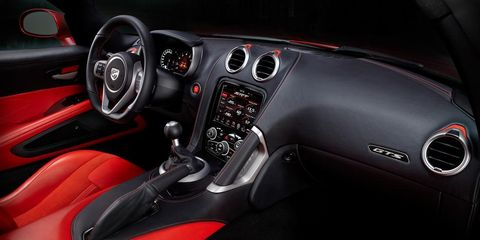 Motor vehicle, Automotive design, Mode of transport, Steering part, Vehicle, Steering wheel, Red, Car, Center console, Speedometer,
