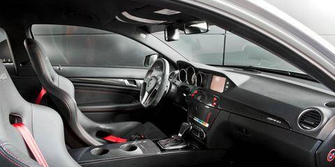 Motor vehicle, Steering part, Automotive design, Steering wheel, Vehicle, Automotive mirror, Center console, Car, Personal luxury car, Vehicle door,