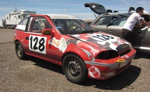 Tire, Vehicle, Land vehicle, Window, Car, Motorsport, Hood, Alloy wheel, Automotive tire, Rim,