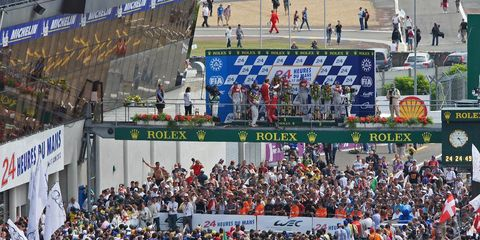 Crowd, People, Sport venue, Audience, Fan, Stadium, Team, Public event, Banner, Cheering,