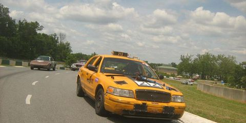 Vehicle, Land vehicle, Road, Automotive parking light, Hood, Car, Road surface, Asphalt, Headlamp, Automotive mirror,