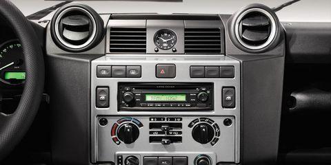 Vehicle audio, Steering part, Center console, Steering wheel, Radio, Electronic device, Technology, Electronics, Black, Machine,