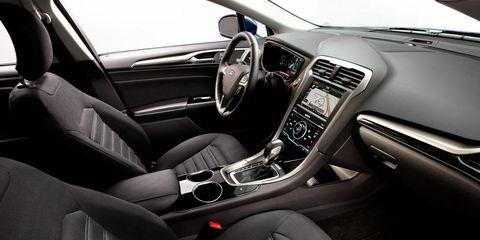 Motor vehicle, Steering part, Automotive design, Steering wheel, Automotive mirror, Center console, Car, White, Personal luxury car, Vehicle audio,