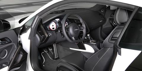 Motor vehicle, Mode of transport, Automotive design, Steering part, Steering wheel, Supercar, Personal luxury car, Center console, Luxury vehicle, Speedometer,