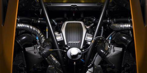 Motor vehicle, Automotive design, Automotive exterior, Engine, Automotive engine part, Grille, Motorcycle accessories, Kit car, Carbon, Wire,