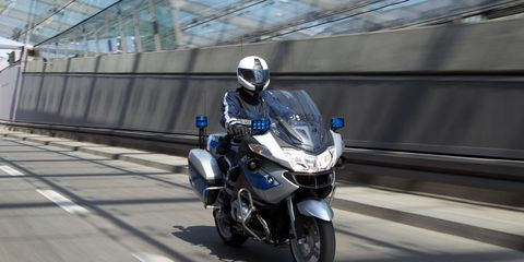 Motorcycle, Motorcycle helmet, Mode of transport, Automotive design, Motorcycling, Shoe, Helmet, Automotive lighting, Automotive tire, Personal protective equipment,