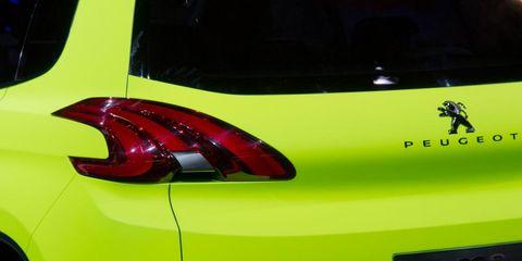 Motor vehicle, Automotive design, Yellow, Vehicle, Automotive exterior, Automotive lighting, Car, Automotive tail & brake light, Fender, Automotive tire,