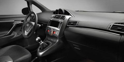 Motor vehicle, Steering part, Automotive design, Steering wheel, Center console, White, Personal luxury car, Luxury vehicle, Vehicle audio, Black,