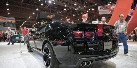 Automotive design, Vehicle, Event, Land vehicle, Auto show, Exhibition, Car, Personal luxury car, Automotive exterior, Automotive lighting,