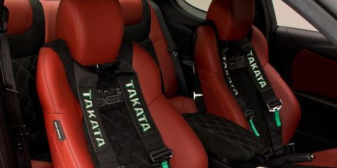 Car seat, Car seat cover, Luxury vehicle, Vehicle door, Head restraint, Leather, Seat belt, Personal luxury car, Armrest, Gear shift,
