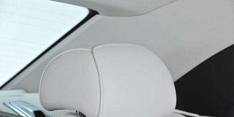 Car seat, Head restraint, Car seat cover, Vehicle door, Family car, Automotive window part, Luxury vehicle, City car, Personal luxury car,