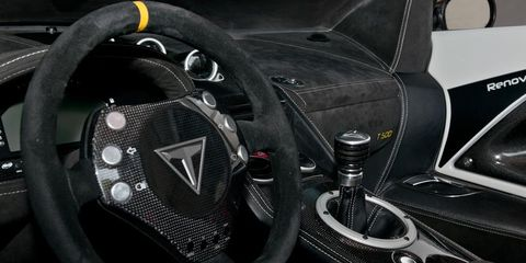 Motor vehicle, Steering part, Automotive design, Steering wheel, Luxury vehicle, Carbon, Sports car, Personal luxury car, Gear shift, Supercar,