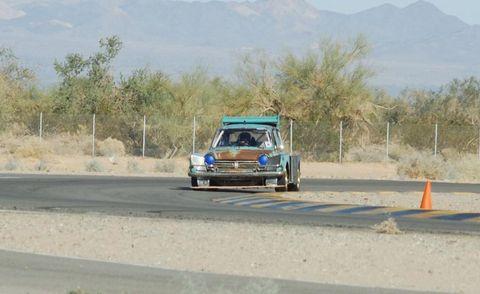 Road, Road surface, Automotive exterior, Asphalt, Classic car, Hill, Plain, Thoroughfare, Teal, Windshield,