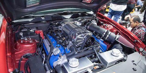 Automotive design, Engine, Automotive engine part, Personal luxury car, Automotive super charger part, Automotive air manifold, Machine, Hood, Fuel line, Luxury vehicle,