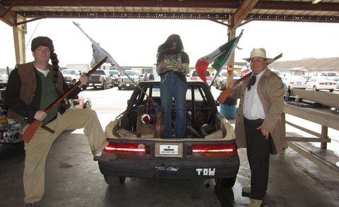 Automotive exterior, Guitar, Travel, Trunk, Bumper, Watercraft, Sun hat, Vehicle registration plate, Boat, Fedora,