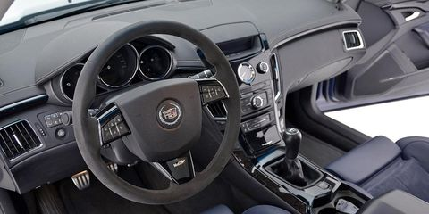 Motor vehicle, Steering part, Mode of transport, Automotive design, Steering wheel, Product, Transport, Center console, Automotive mirror, White,