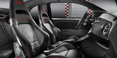 Motor vehicle, Mode of transport, Automotive design, Vehicle, Car seat, Red, Car, Steering part, Car seat cover, Steering wheel,