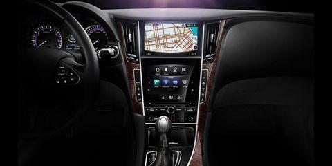 Automotive design, Center console, Steering part, Vehicle audio, Steering wheel, Electronic device, Radio, Luxury vehicle, Gear shift, Technology,