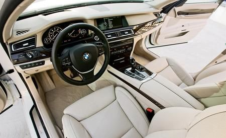 Motor vehicle, Steering part, Automotive mirror, Steering wheel, Vehicle door, White, Center console, Vehicle audio, Car seat, Personal luxury car,
