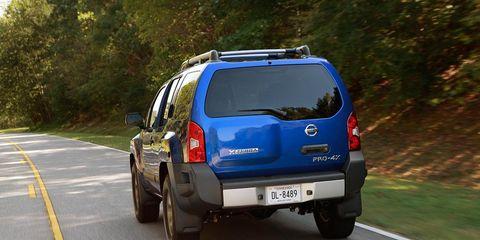 Tire, Motor vehicle, Wheel, Automotive tail & brake light, Automotive tire, Mode of transport, Road, Automotive mirror, Automotive exterior, Vehicle,