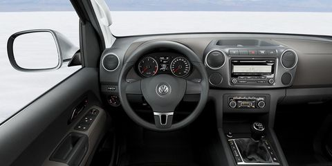 Motor vehicle, Steering part, Mode of transport, Product, Automotive design, Steering wheel, Transport, Automotive mirror, Center console, White,