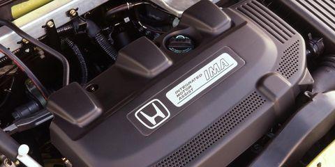 Automotive design, Automotive exterior, Engine, Bumper, Personal luxury car, Automotive engine part, Luxury vehicle, Automotive air manifold, Machine, Carbon,