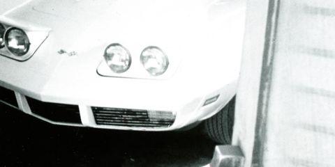 Motor vehicle, Automotive design, Headlamp, Automotive lighting, White, Automotive tire, Automotive exterior, Grille, Hood, Fender,
