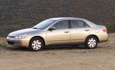 Tire, Wheel, Vehicle, Land vehicle, Transport, Infrastructure, Car, Automotive parking light, Full-size car, Rim,
