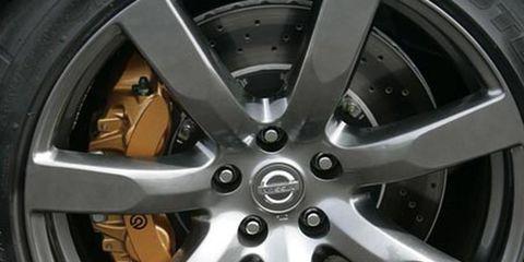 Wheel, Alloy wheel, Spoke, Automotive wheel system, Rim, Automotive tire, Synthetic rubber, Hubcap, Auto part, Black,