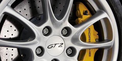 Wheel, Alloy wheel, Spoke, Automotive wheel system, Rim, Auto part, Hubcap, Automotive tire, Black, Synthetic rubber,
