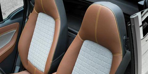 Motor vehicle, Automotive design, Car seat, Vehicle door, Car seat cover, Head restraint, Tan, Luxury vehicle, Seat belt, Convertible,