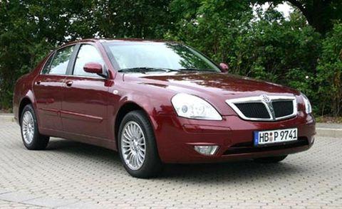 Tire, Motor vehicle, Wheel, Mode of transport, Automotive mirror, Glass, Vehicle, Transport, Hood, Land vehicle,