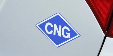 Motor vehicle, Text, Electric blue, Logo, Symbol, Carmine, Sign, Cobalt blue, Signage, Trademark,
