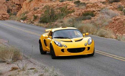 Mode of transport, Road, Automotive design, Yellow, Vehicle, Headlamp, Infrastructure, Car, Asphalt, Hood,