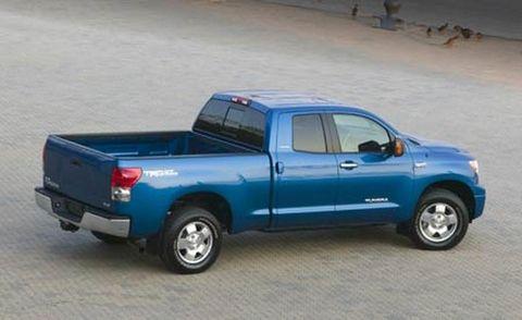 Tire, Motor vehicle, Wheel, Blue, Automotive tire, Vehicle, Natural environment, Pickup truck, Automotive design, Land vehicle,