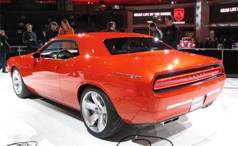Motor vehicle, Tire, Automotive design, Vehicle, Land vehicle, Automotive tire, Transport, Car, Automotive exterior, Red,