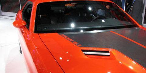 Automotive design, Vehicle, Car, Hood, Automotive exterior, Vehicle door, Glass, Orange, Performance car, Windshield,