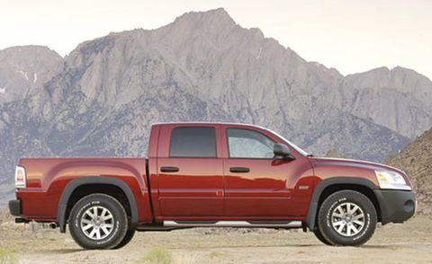 Tire, Wheel, Motor vehicle, Automotive tire, Vehicle, Natural environment, Land vehicle, Mountainous landforms, Rim, Automotive design,