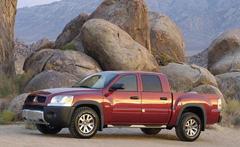 Motor vehicle, Tire, Wheel, Automotive mirror, Automotive tire, Vehicle, Land vehicle, Hood, Landscape, Automotive exterior,