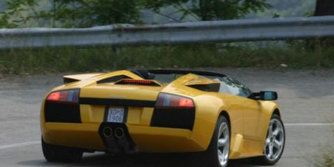 Tire, Wheel, Mode of transport, Automotive design, Vehicle, Yellow, Automotive exterior, Transport, Infrastructure, Rim,