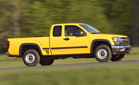 Tire, Motor vehicle, Wheel, Automotive tire, Vehicle, Natural environment, Yellow, Automotive design, Pickup truck, Automotive wheel system,