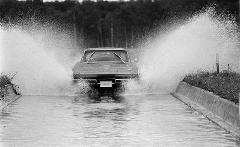 Automotive exterior, Atmospheric phenomenon, Auto part, Monochrome, Dust, Smoke, Hood, Water transportation, Classic car, Kit car,