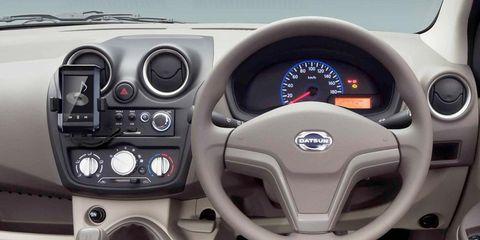 Motor vehicle, Mode of transport, Steering part, Product, Steering wheel, Transport, Vehicle, Automotive design, Red, Speedometer,