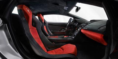 Motor vehicle, Automotive design, Red, Vehicle door, Carmine, Steering wheel, Car seat, Luxury vehicle, Steering part, Personal luxury car,