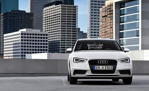 Automotive design, Daytime, Tower block, Vehicle, Grille, Headlamp, Car, Audi, Vehicle registration plate, Metropolitan area,
