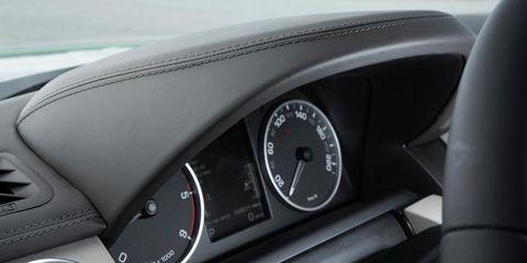 Motor vehicle, Mode of transport, Speedometer, Gauge, Steering wheel, Tachometer, Steering part, Black, Measuring instrument, Luxury vehicle,