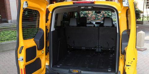 Motor vehicle, Mode of transport, Yellow, Vehicle door, Automotive exterior, Van, Light commercial vehicle, Commercial vehicle, Bumper, Trunk,