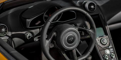Motor vehicle, Mode of transport, Automotive design, Steering part, Steering wheel, White, Speedometer, Black, Grey, Luxury vehicle,