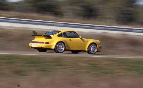 Tire, Wheel, Yellow, Vehicle, Automotive design, Motorsport, Car, Performance car, Automotive exterior, Fender,