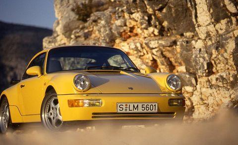 Automotive design, Yellow, Vehicle, Transport, Land vehicle, Car, Automotive lighting, Vehicle registration plate, Headlamp, Fender,